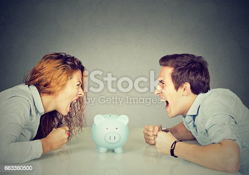 istock Wife and husband can not make settlement screaming piggy bank in-between 663360500
