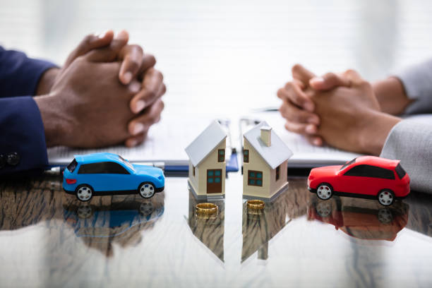 Wife And Husband Splitting House And Car stock photo