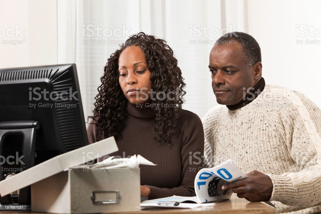 Wife and Husband Working on Taxes royalty-free stock photo