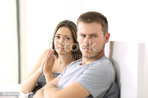 istock Wife begging and angry husband 827904376