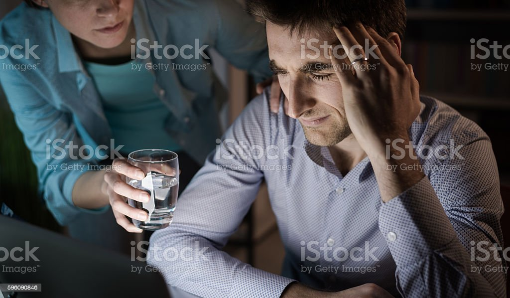 Wife comforting her husband royalty-free stock photo