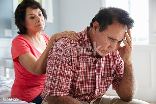 istock Wife Comforting Senior Husband Suffering With Dementia 519664394