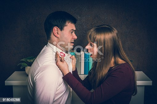 185866319istockphoto Wife finded red lipstick on shirt collar - infidelity concept 918045288