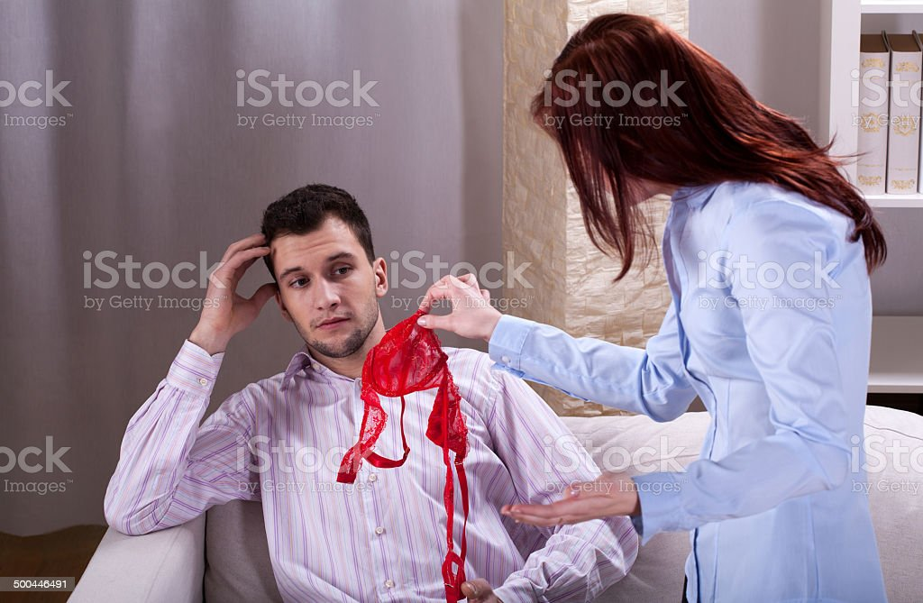Wife finds somebody's underwear near husband stock photo