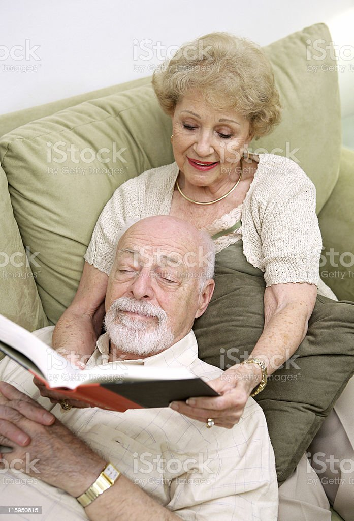Wife Reading to Husband royalty-free stock photo