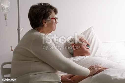 886711404 istock photo Wife supporting dying ill husband 800394950