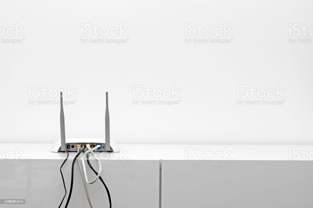 wifi internet router on shelf in white interior stock photo
