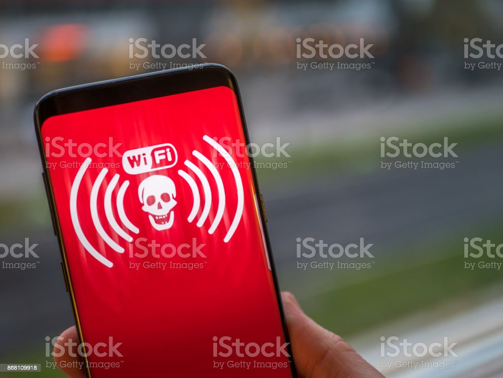 Wifi virus. Mobile phone display show infected and hacked wireless network. Smart phone concept. stock photo