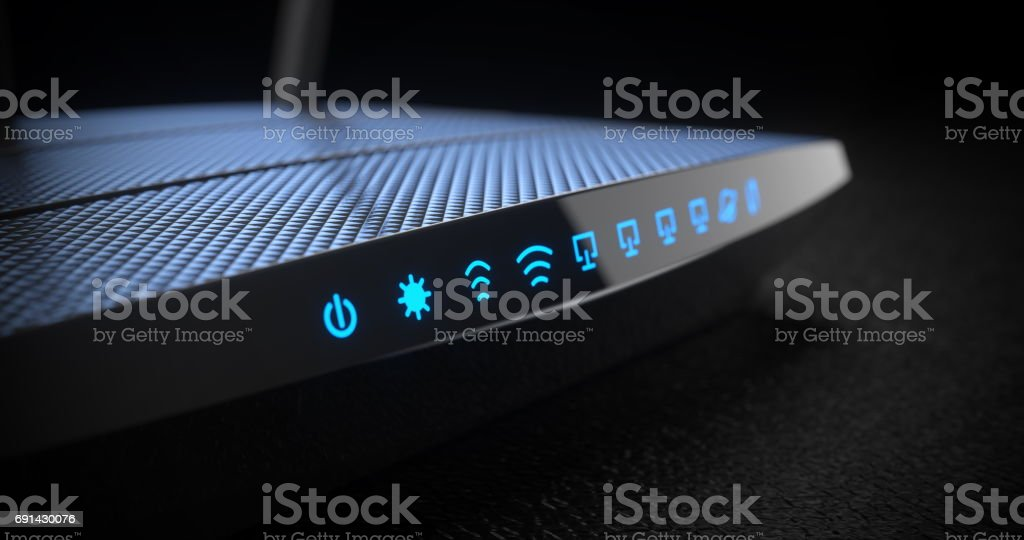 Wi-Fi wireless internet router on dark background stock photo