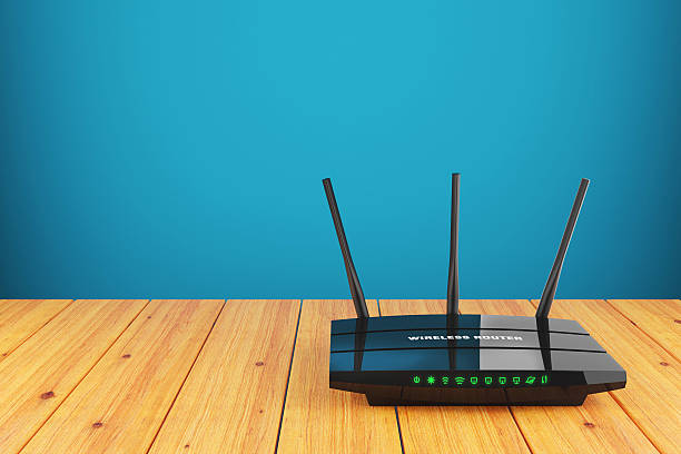 Wi-Fi wireless router on wooden table stock photo