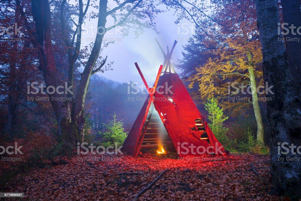 wigwam tipi and bonfire stock photo
