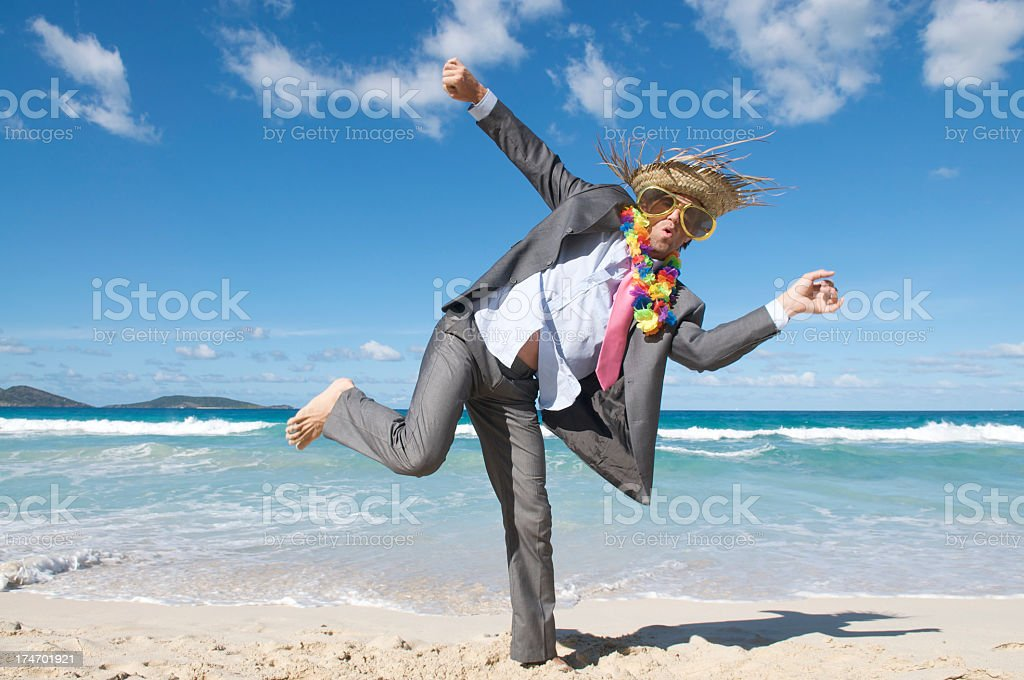 Wild and Crazy Tourist Businessman Dancing Outdoors on Beach royalty-free stock photo