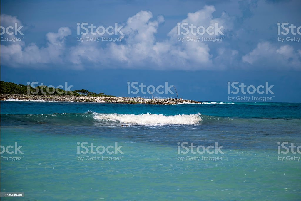 wild and paradise beach with waves and tropical water stock photo