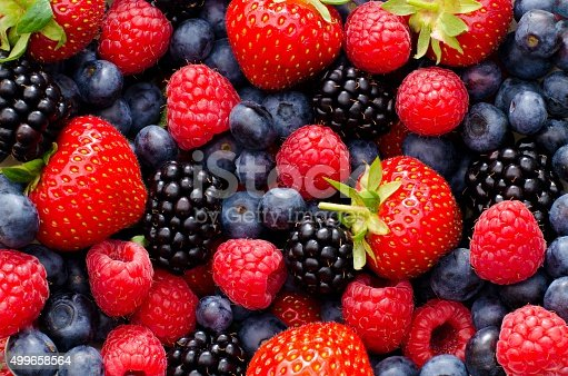 Close up / Macro photography of wild berry mix - strawberries, blueberries, blackberries and raspberries