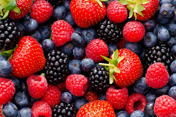 wild berry mix - strawberries, blueberries, blackberries and raspberries - berry stock photos and pictures