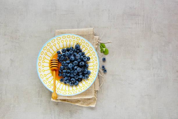 Wild blueberry bowl stock photo