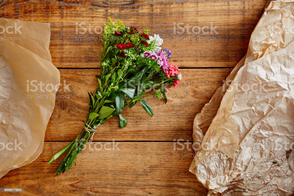 wild bouquet of flowers on wooden table stock photo