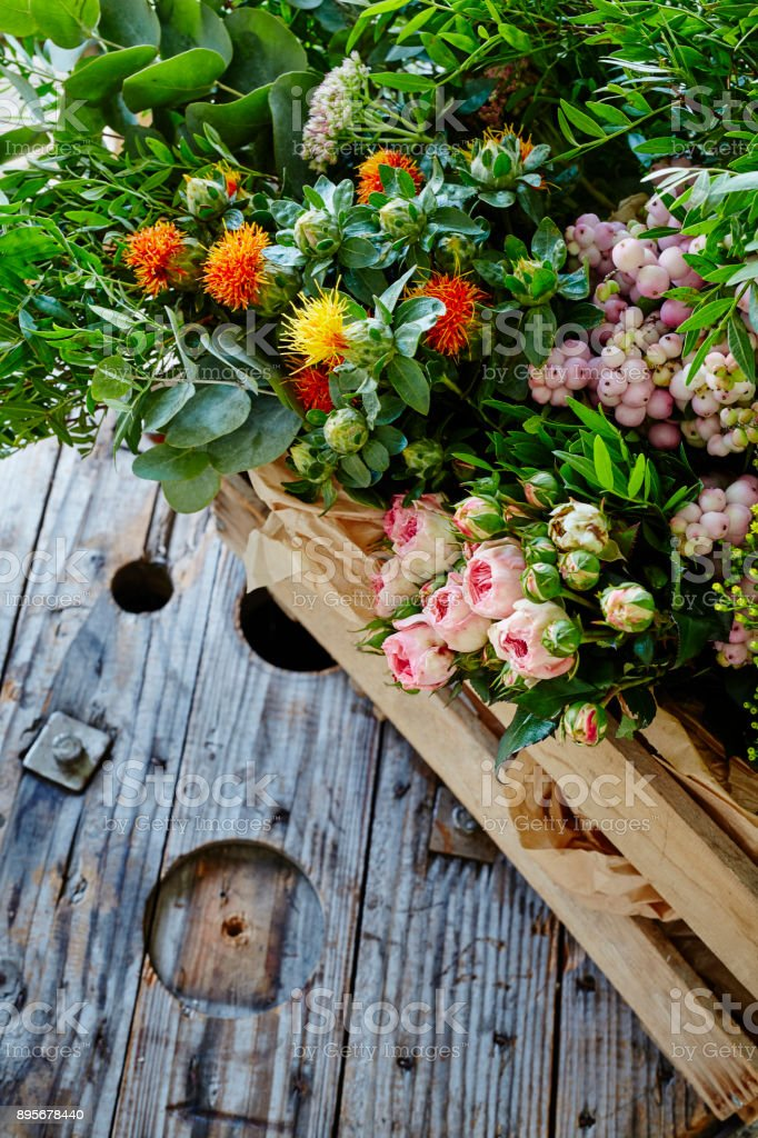 wild bunch of flowers in wooden box stock photo