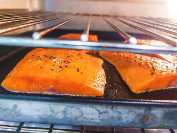 Wild Caught Healthy Salmon Steaks Prepared for Baking in Domestic Kitchen Oven In Western Colorado Wild Caught Healthy Salmon Steaks Prepared for Baking in Domestic Kitchen Oven Matching 4K Video Available (Shot with iPhone 12 Pro Max 12mp 4032×3024 photos professionally retouched - Lightroom / Photoshop -downsampled as needed for clarity and select focus used for dramatic effect) eyecrave stock pictures, royalty-free photos & images