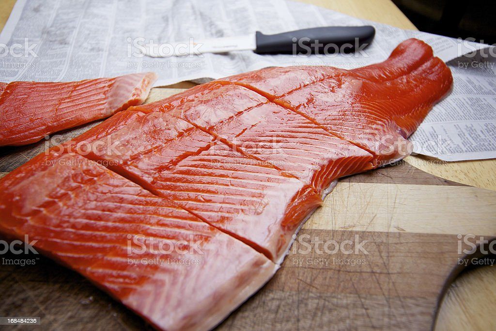 Wild Caught Salmon raw fillet on cutting board stock photo