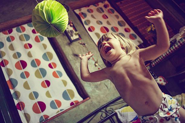wild child jumping on bed - anti unordnung stock-fotos und bilder