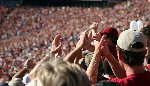wild fans at sporting event - sports event stock photos and pictures