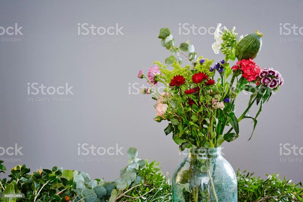 wild flowers bouquet in vase stock photo