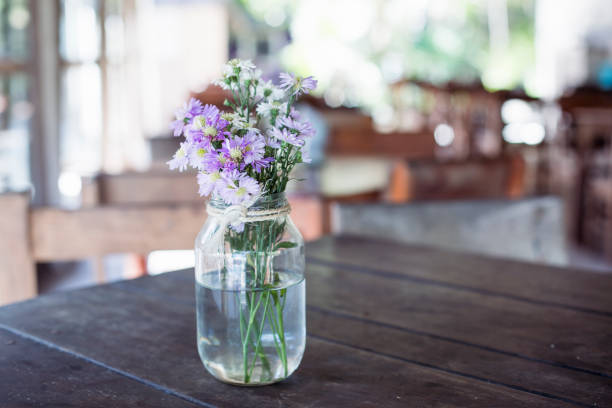 wild flowers bouquet on a table - vase stock pictures, royalty-free photos & images
