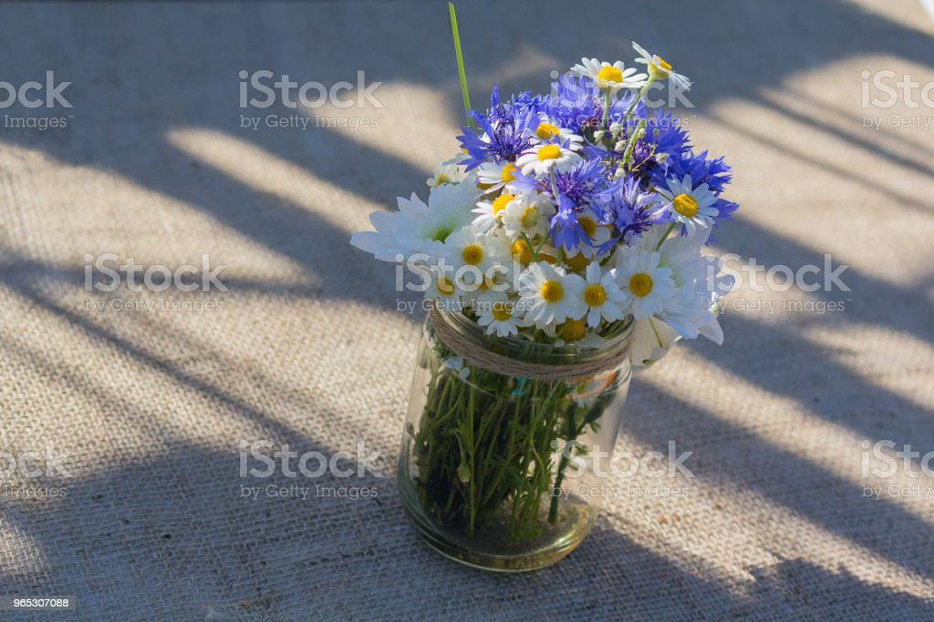 Wild flowers in a glass jar. Decoration royalty-free stock photo