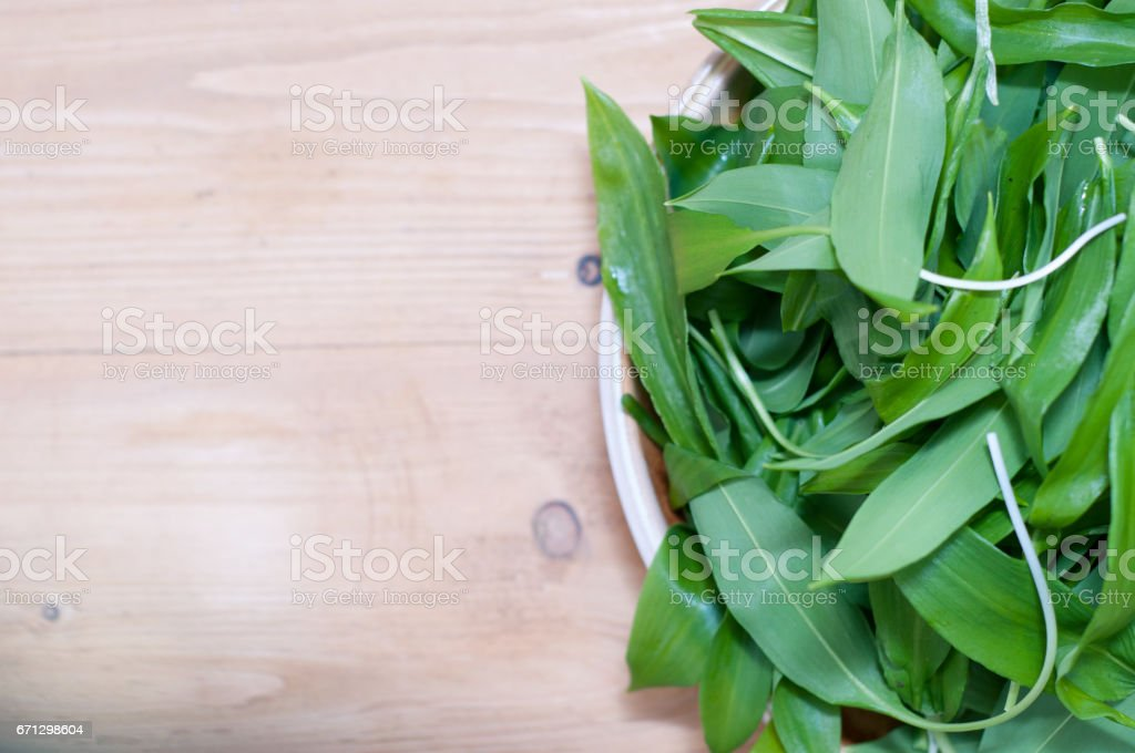 wild garlic, ramsons on wooden table closeup stock photo