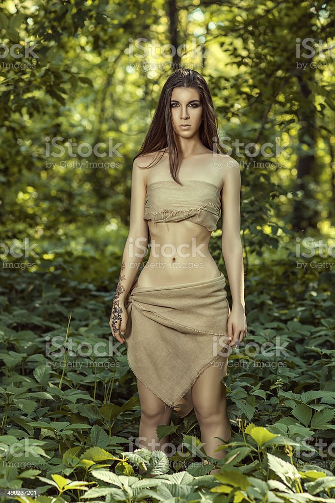 Wild girl in the woods. stock photo