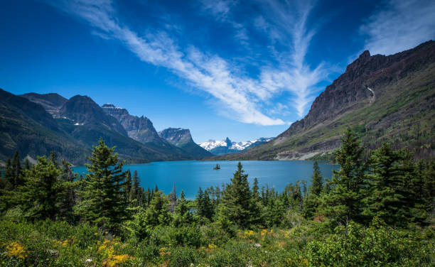 wild goose island in st. mary lake - us glacier national park stock pictures, royalty-free photos & images