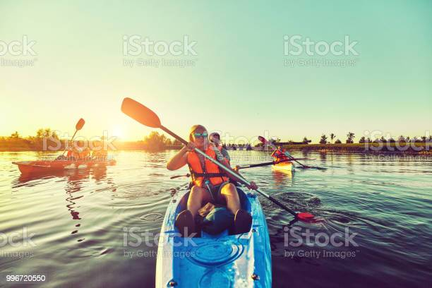 Photo of Wild nature and water fun on summer vacation. Camping and fishing.