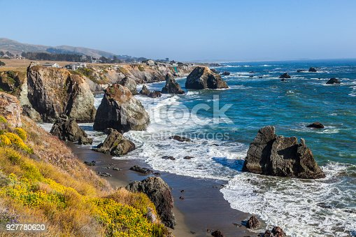 wild pacific coast with cliffs and huge waves