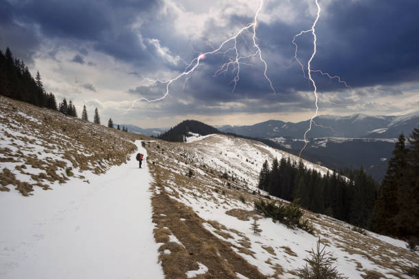 wild peaks of the Carpathians in a thunderstorm stock photo