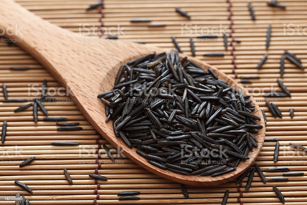 Wild rice in a wooden spoon royalty-free stock photo