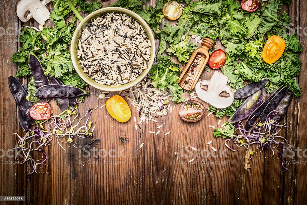 Wild rice with kale and vegetables ingredients for tasty cooking stock photo