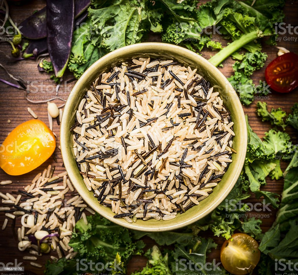 Wild rice with vegetables ingredients, close up, top view. stock photo