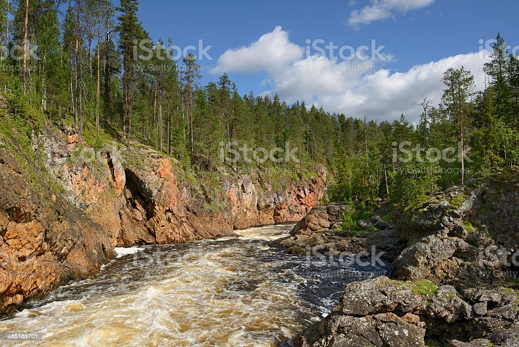 Wild River with rocky shores= stock photo