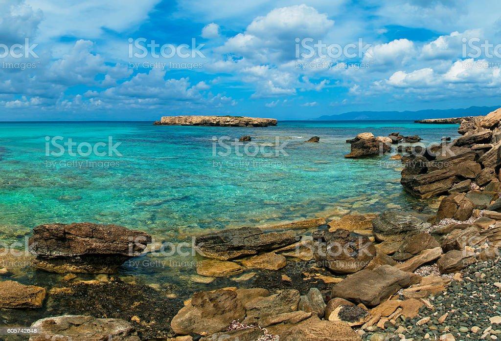wild rocky beach at blue lagoon on sunny day stock photo