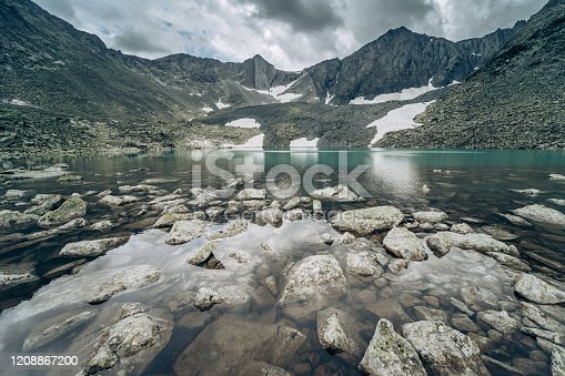 istock Wild russian nature. Beautiful landscape with emerald lake in the mountains. Lake with clear turquoise water. Traveling in the Altai Republic. Tourism in Russia. Siberian reserve. Melting glacier. 1208867200