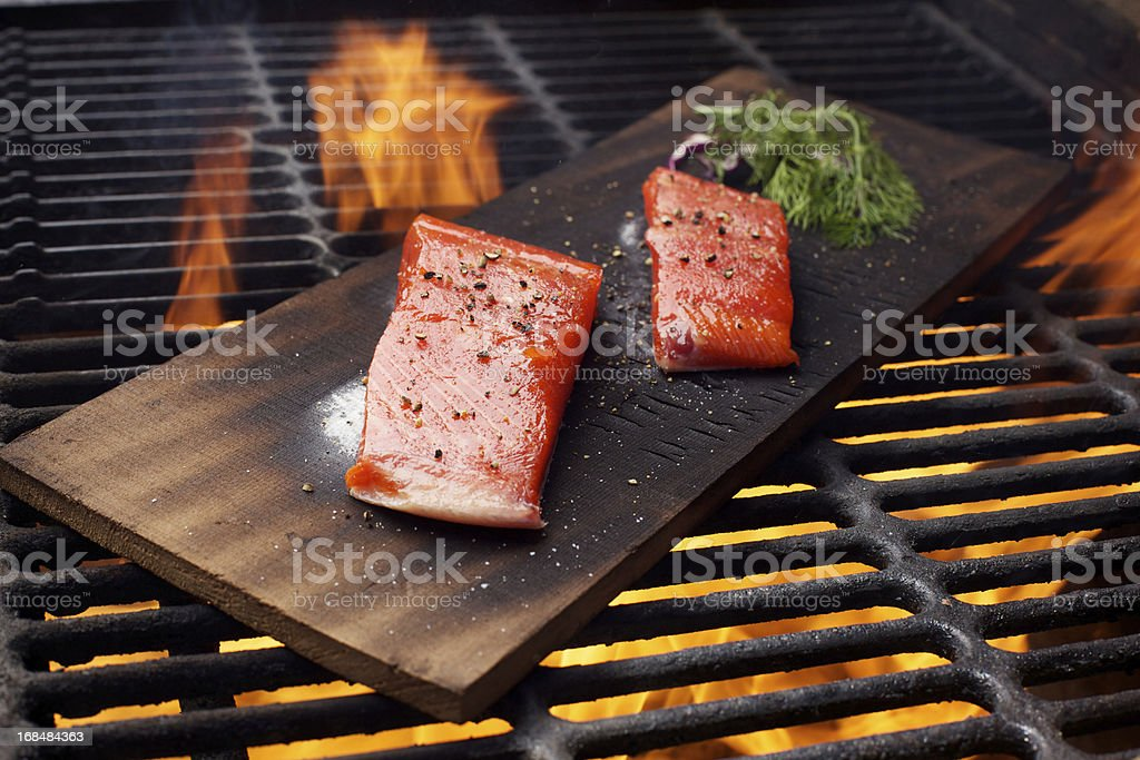 Wild Salmon fillet outdoor cedar plank bbq grill stock photo