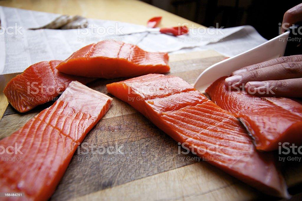 Wild Salmon raw fillet on cutting board royalty-free stock photo