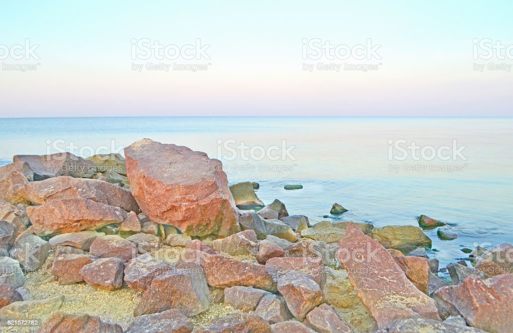 Wild sea landscape with the stony coast. Romantic sea landscape. stock photo