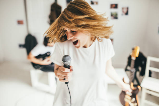 wild singer - singing stock photos and pictures