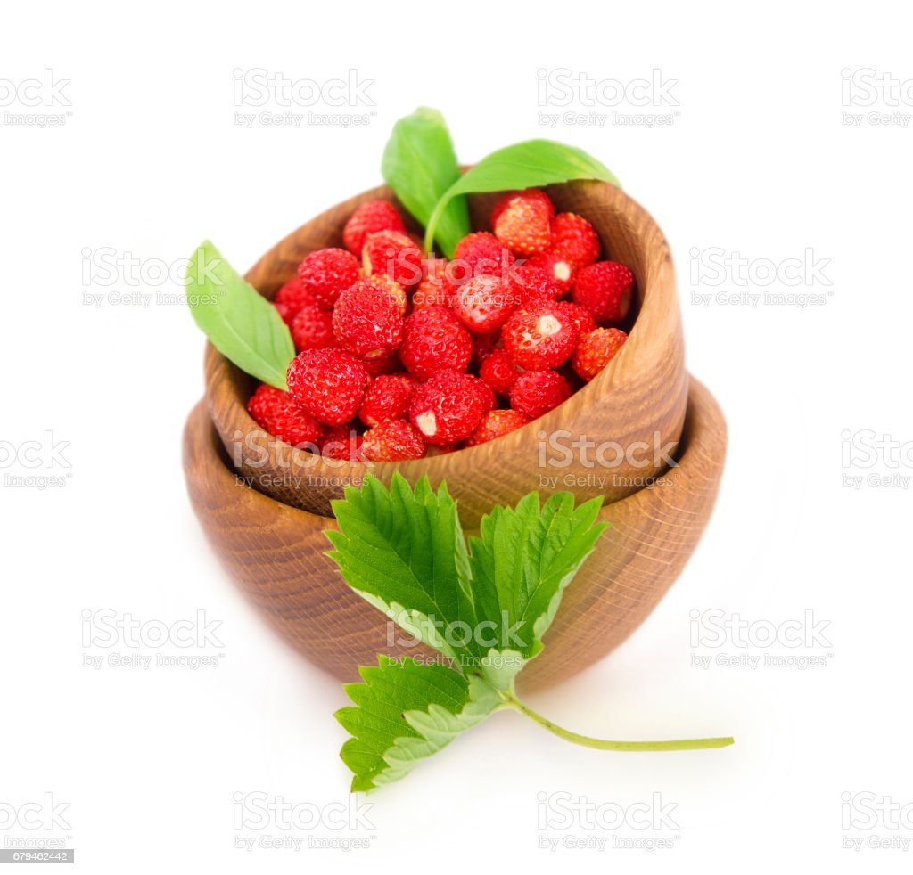 Wild small strawberries isolated on white background. royalty-free stock photo
