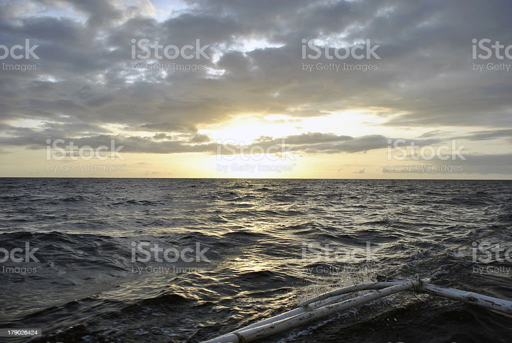 Wild waves out in the ocean during sunset stock photo