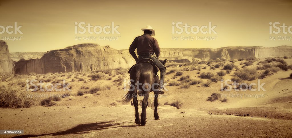 Wild West Cowboy on Horse, Old Retro Antique Sepia Tone stock photo