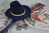 Wild west period repeating rifle with ammunition and sheriff badge