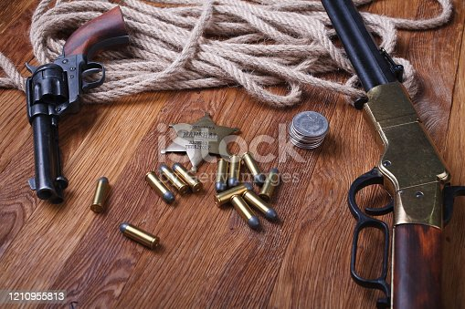 istock Wild west rifle, ammunition and sheriff badge 1210955813